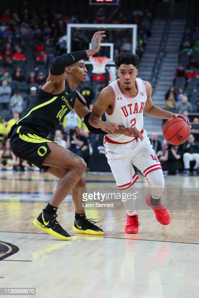 Timmy Allen of the Utah Utes handles the ball in the 2nd half against Kenny Wooten of the Oregon Ducks during a quarterfinal game of the Pac12...