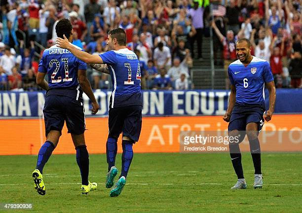 Timmy Chandler of the United States is congratulated by teammaters Greg Garza and John Brooks after a goal against of Guatemala during the first half...