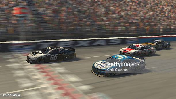 Timmy Hill, driver of the Roofclaim.com Totota, crosses the finish line to win ahead of Ryan Preece, driver of the Cottonelle Chevrolet, during the...