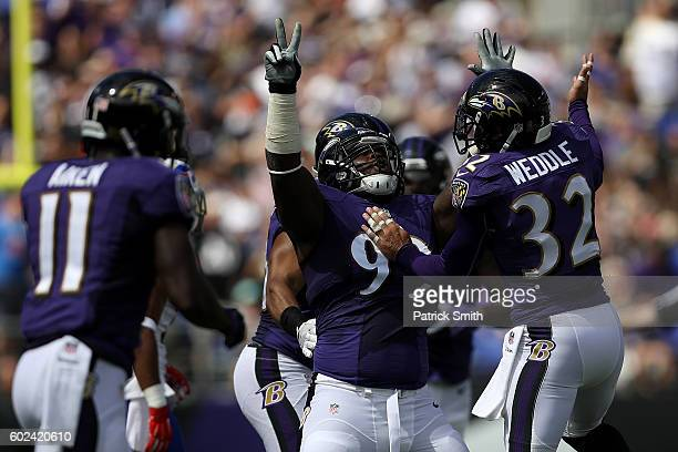 Timmy Jernigan of the Baltimore Ravens and defensive back Eric Weddle of the Baltimore Ravens celebrate after a sack in the first half of the Buffalo...
