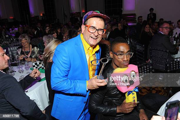 Timmy Mallett and Simon Webbe attends the Spectacle Wearer Of the year Awards at 8 Northumberland Avenue on October 7 2014 in London England