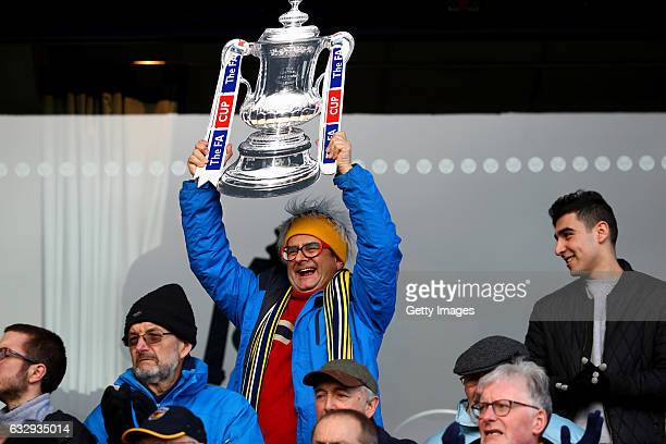 Timmy Mallett holds up an FA Cup during The Emirates FA Cup Fourth Round match between Oxford United and Newcastle United at Kassam Stadium on...