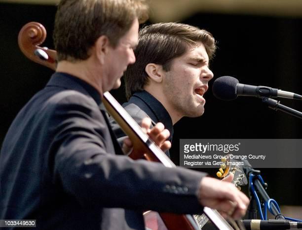 Timmy Milner plays the mandolin, during funeral services for his grandpa, Robert H. Schuller. ///ADDITIONAL INFORMATION: Ð MINDY SCHAUER, ORANGE...
