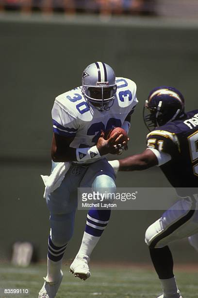 Timmy Newsome of the Dallas Cowboys runs with the ball during a NFL exibition football game against the San Diego Chargers game on August 22 1989 at...