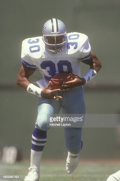 Timmy Newsome of the Dallas Cowboys runs with the ball during a preseason football game against the San Diego Chargers on August 14 1989 at Jack...