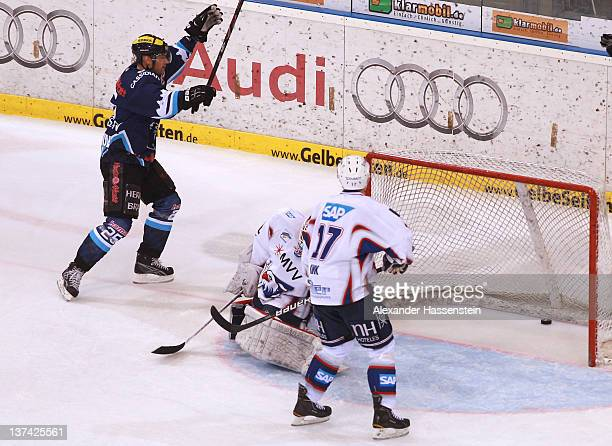 Timmy Pettersson of Ingolstadt scores the 3rd team goal against Fredrick Brathwaite, goalie of Mannheim and his team mate Marcus Kink during the DEL...