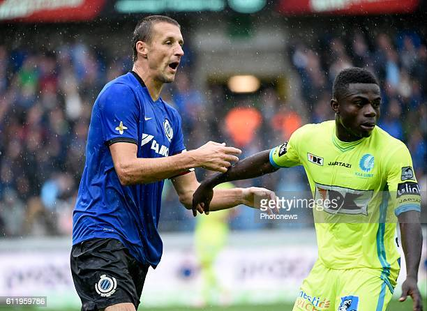Timmy Simons midfielder of Club Brugge and Simon Moses forward of KAA Gent pictured during Jupiler Pro League match between Club Brugge KV and KAA...