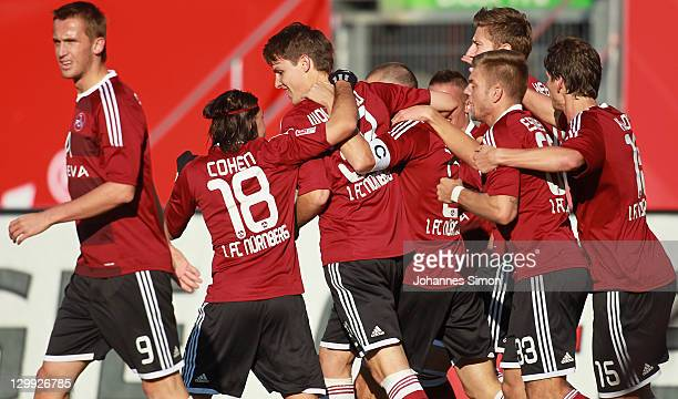 Timmy Simons of Nuernberg celebrates with his team mates after scoring his team' first goal during the Bundesliga match between 1FC Nuernberg and VfB...