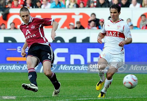 Timmy Simons of Nuernberg scores the opening goal past Tamas Hajnal of Stuttgart during the Bundesliga match between VfB Stuttgart and 1. FC...