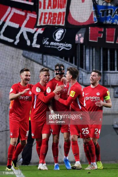 Timmy Thiele of 1. FC Kaiserslautern celebrates after scoring his team's second goal with his team mates during the DFB Cup second round match...