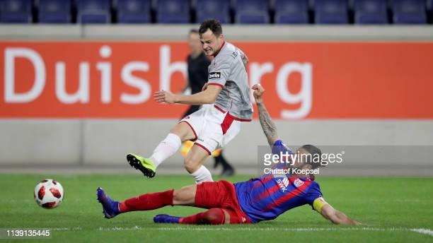 Timmy Thiele of Kaiserslautern scores thew third goal against Dominic Maroh of Krefeld during the 3 Liga match between KFC Uerdingen 05 and 1 FC...