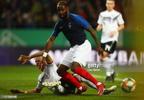 Timo Baumgartl of Germany challenges Moussa Dembele of France during the Germany U21 v France U21 International Friendly match on March 21 2019 in...