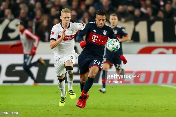 Timo Baumgartl of Stuttgart and Corentin Tolisso of Bayern Muenchen battle for the ball during the Bundesliga match between VfB Stuttgart and FC...