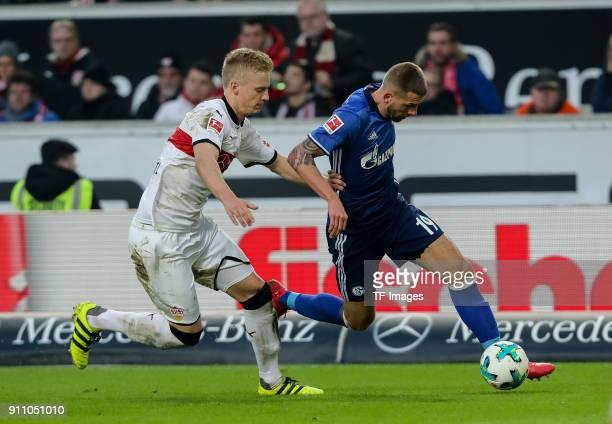 Timo Baumgartl of Stuttgart and Guido Burgstaller of Schalke battle for the ball during the Bundesliga match between VfB Stuttgart and FC Schalke 04...