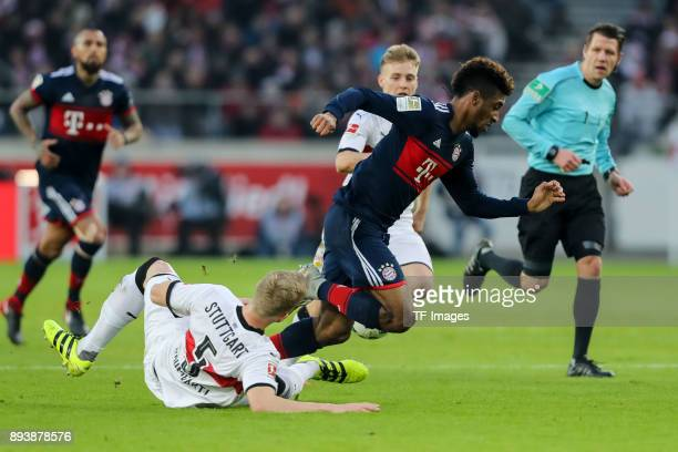 Timo Baumgartl of Stuttgart and Kingsley Coman of Muenchen battle for the ball during the Bundesliga match between VfB Stuttgart and FC Bayern...