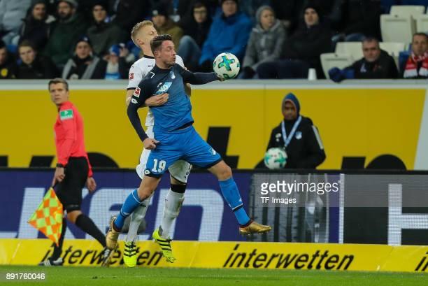 Timo Baumgartl of Stuttgart and Mark Uth of Hoffenheim battle for the ball during the Bundesliga match between TSG 1899 Hoffenheim and VfB Stuttgart...