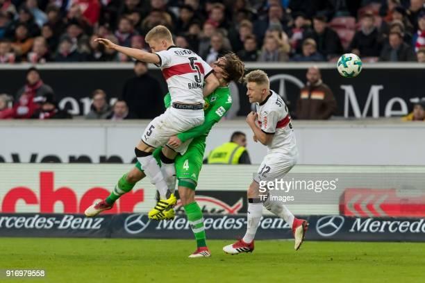 Timo Baumgartl of Stuttgart Andreas Beck of Stuttgart and Jannik Vestergaard of Moenchengladbach battle for the ball during the Bundesliga match...