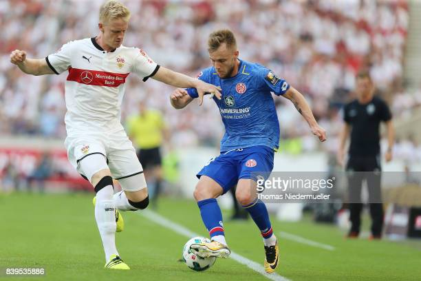 Timo Baumgartl of Stuttgart fights for the ball with Alexandru Maxim of Mainz during the Bundesliga match between VfB Stuttgart and 1 FSV Mainz 05 at...