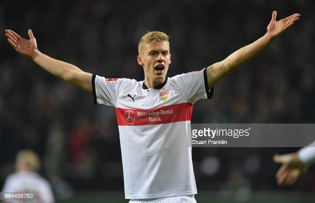 Timo Baumgartl of Stuttgart signals to the referees assistant for a video judgement off side for the second goal during the Bundesliga match between...
