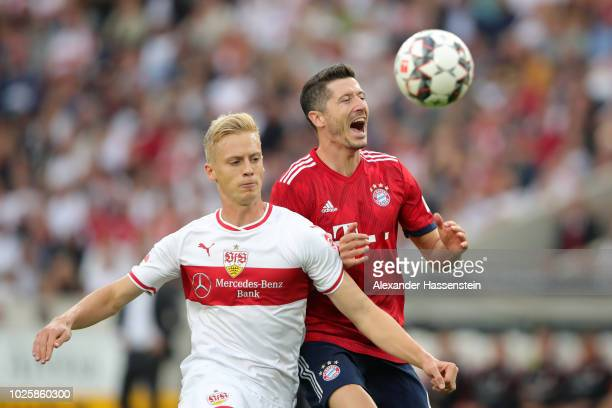 Timo Baumgartl of VfB Stuttgart and Robert Lewandowski of Bayern Munich battles for possession during the Bundesliga match between VfB Stuttgart and...