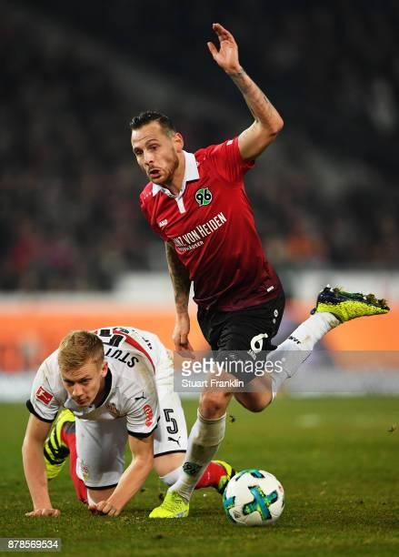 Timo Baumgartl of VfB Stuttgart challenges Marvin Bakalorz of Hannover 96 during the Bundesliga match between Hannover 96 and VfB Stuttgart at...