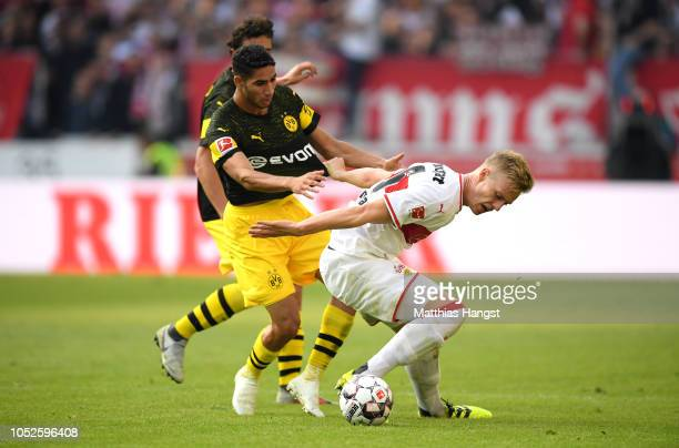 Timo Baumgartl of VfB Stuttgart is challenged by Achraf Hakimi of Borussia Dortmund during the Bundesliga match between VfB Stuttgart and Borussia...