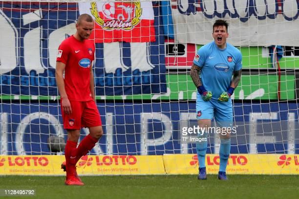 Timo Beermann of 1. FC Heidenheim and goalkeeper Kevin Mueller of 1. FC Heidenheim gestures during the Second Bundesliga match between 1. FC...