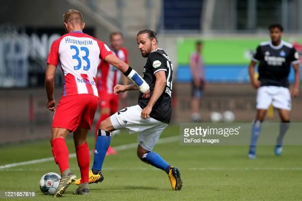 Timo Beermann of 1.FC Heidenheim 1846 and Martin Harnik of Hamburger SV battle for the ball during the Second Bundesliga match between 1. FC...