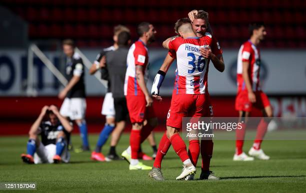 Timo Beermann of Heidenheim celebrate with team mate Niklas Dorsch after the Second Bundesliga match between 1. FC Heidenheim 1846 and Hamburger SV...