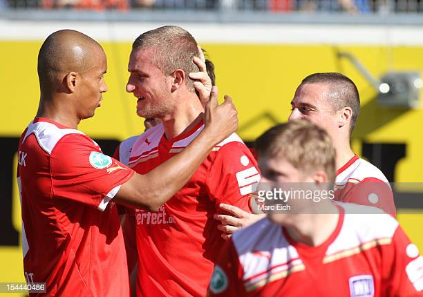 Timo Beermann of Osnabrueck celebrates his goal during the third league match between 1. FC Heidenheim and VfL Osnabrueck at Voith-Arena on October...