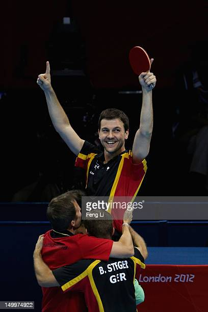 Timo Boll Dimitrij Ovtcharov Bastian Steger and coach of Germany celebrate Boll defeating Tianyi Jiang of Hong Kong China and winning the Men's Team...