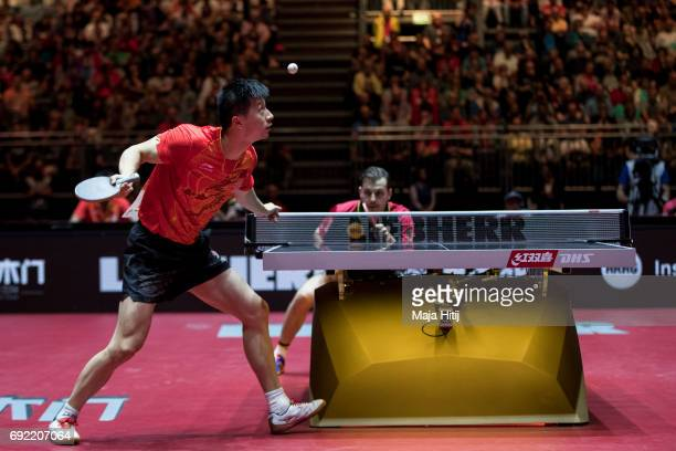 Timo Boll of Germany and Ma Long of China in action during men's quarter final at Table Tennis World Championship at at Messe Duesseldorf on June 4...