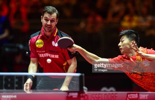 Timo Boll of Germany and Mo Long of China in action during the Table Tennis World Championship at Messe Duesseldorf on May 30, 2017 in Dusseldorf,...