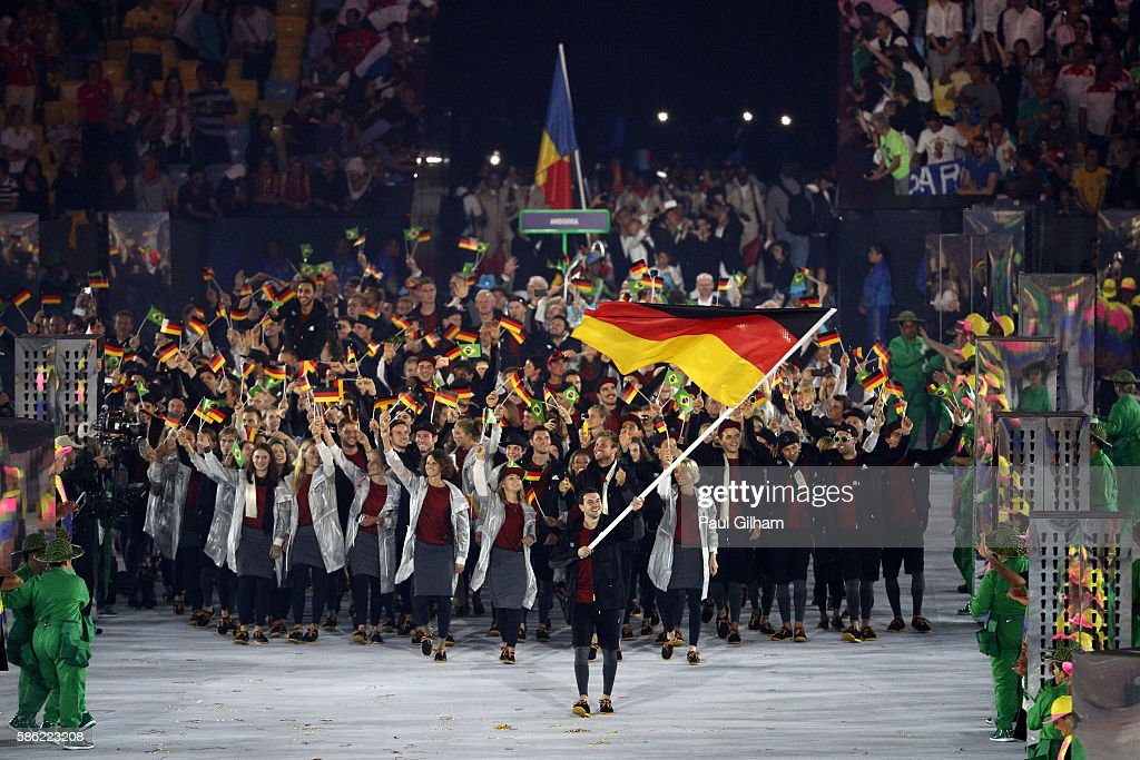 Timo Boll of Germany carries his country's flag during the Opening Ceremony of the Rio 2016 Olympic Games at Maracana Stadium on August 5, 2016 in Rio de Janeiro, Brazil.