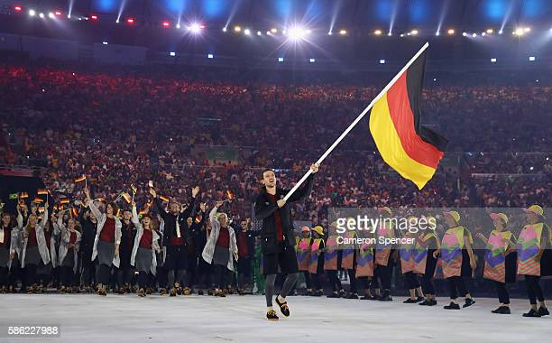 Timo Boll of Germany carries the flag during the Opening Ceremony of the Rio 2016 Olympic Games at Maracana Stadium on August 5 2016 in Rio de...