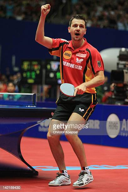 Timo Boll of Germany celebrates his victory after his match against Jun Mizutani of Japan during the LIEBHERR table tennis team world cup 2012...