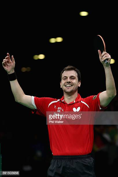 Timo Boll of Germany celebrates the Bronze Medal winning point during the Men's Team Bronze Medal match between Korea and Germany at the Rio Centro...