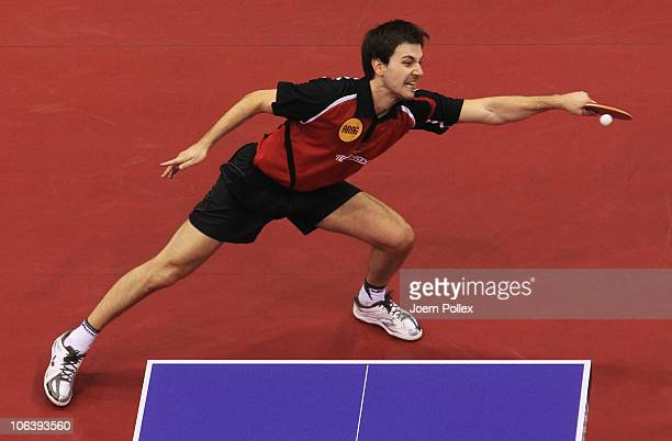 Timo Boll of Germany competes against Jun Mizutani of Japan during their Table Tennis World Cup 2010 3rd place match at the Boerdeland Hall on...