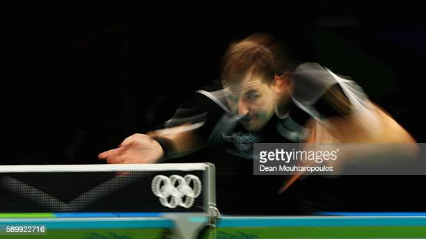 Timo Boll of Germany competes against Jun Mizutani of Japan during the Table Tennis Men's Team Round Semi Final between Japan and Germany during Day...