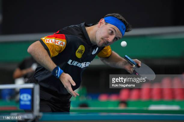 Timo Boll of Germany competes against Maharu Yoshimura of Japan during Men's Teams singles Quarterfinals Match 2 on day two of the ITTF Team World...