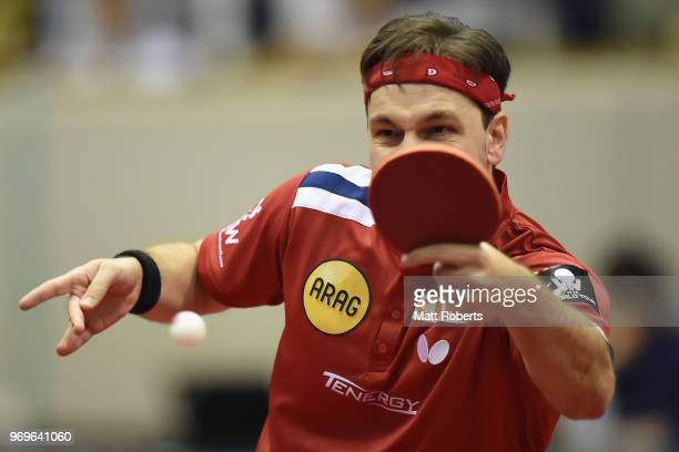 Timo Boll of Germany competes against Yuta Tanaka of Japan during the men's singles round one match on day one of the ITTF World Tour LION Japan Open...
