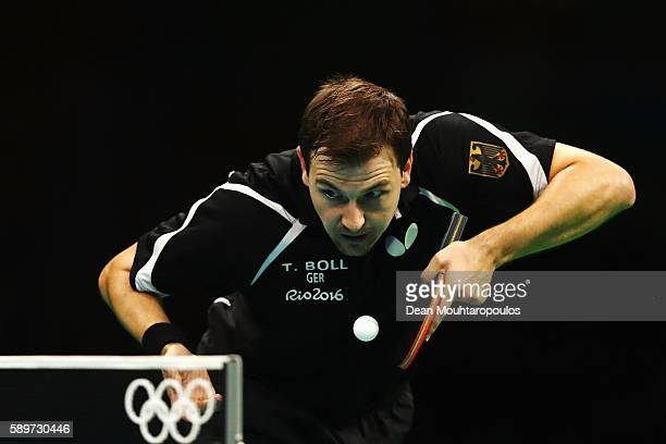 Timo Boll of Germany in action against Jun Mizutani of Japan during Mens Team Semifinal on Day 10 of the Rio 2016 Olympic Games at Riocentro Pavilion...