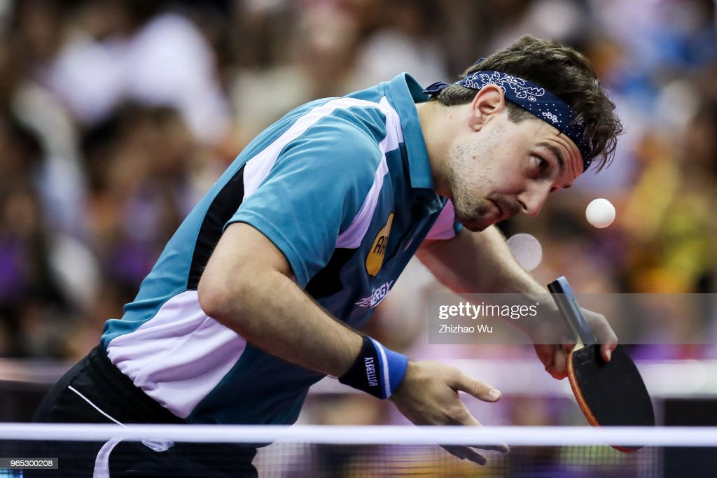 Timo Boll of Germany in action at the men's singles match Round of 16 compete with Liang Jingkun of China during the 2018 ITTF World Tour China Open on June 1, 2018 in Shenzhen, China.