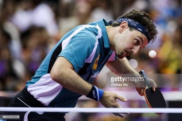 Timo Boll of Germany in action at the men's singles match Round of 16 compete with Liang Jingkun of China during the 2018 ITTF World Tour China Open...