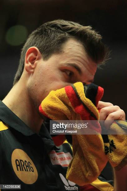 Timo Boll of Germany looks dejected after losing his match against Zhang Jike of China during the LIEBHERR table tennis team world cup 2012...