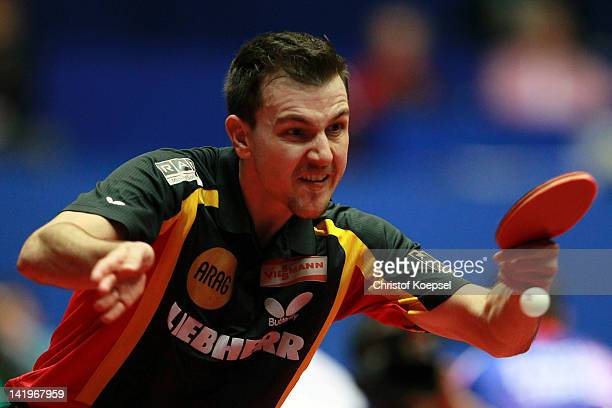 Timo Boll of Germany plays a backhand during his match against Joao Monteiro of Portugal during the LIEBHERR table tennis team world cup 2012...