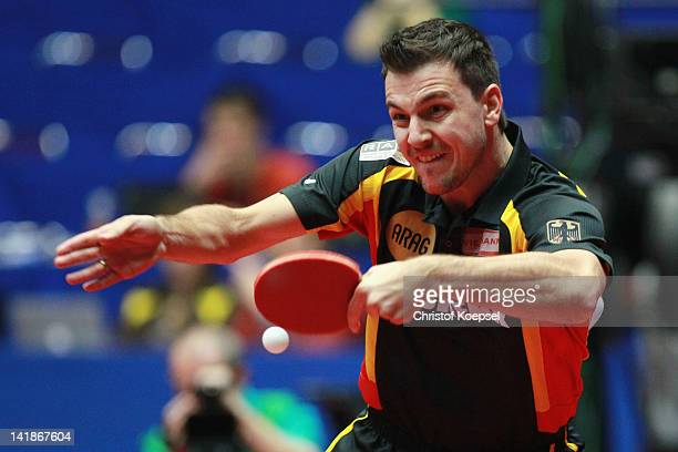 Timo Boll of Germany plays a backhand during his match against Dmitrij Prokopcov of Czech Republic during the LIEBHERR table tennis team world cup...