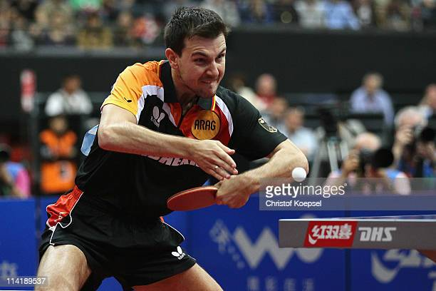 Timo Boll of Germany plays a backhand during the Men's Single Semi Final match between Timo Boll and Zhang Jike of China during the World Table...