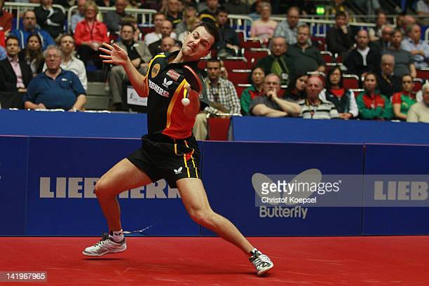 Timo Boll of Germany plays a forehand during his match against Joao Monteiro of Portugal during the LIEBHERR table tennis team world cup 2012...