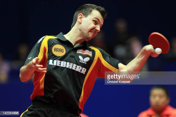 Timo Boll of Germany plays a forehand during his match against Zhang Jike of China during the LIEBHERR table tennis team world cup 2012 championship...